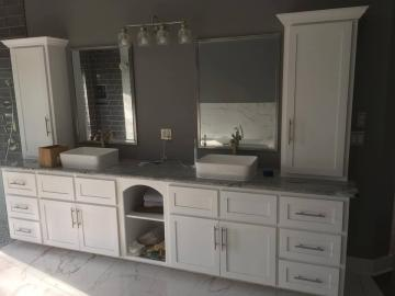 Maple Bath Vanity cabinet with Shaker style doors and painted with white lacquer paint & Granite tops.